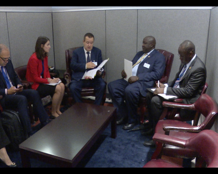Ivica Dacic with Henry Okello